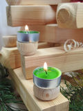 Small candles on boards. Stock Photography