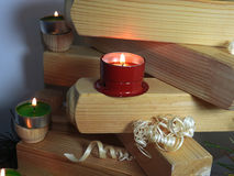 Small candles on boards. Stock Photos