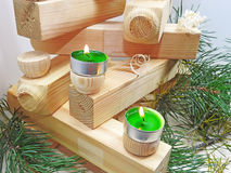Small candles on boards. Stock Image