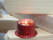 Small candles on boards. Stock Photo