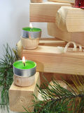 Small candles on boards. Royalty Free Stock Photography