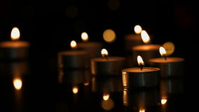 Small candles burning brightly stock video