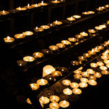 Small candles burning in catholic church Royalty Free Stock Image