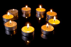 Small candles in a circle Royalty Free Stock Images