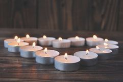 Small candles - pills stand on a wooden table royalty free stock photography
