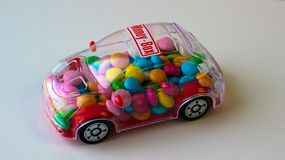 Candy in toy car - money box stock photos
