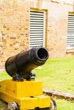 Small Cannon on Yellow Stand Stock Image