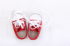 Small canvas shoes top view on white Royalty Free Stock Photography