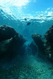 Small canyon underwater Pacific ocean. Small canyon underwater carved by swell into the reef, Huahine island, Pacific ocean, French Polynesia Royalty Free Stock Photo