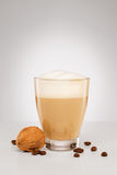 Small cappuccino with a walnut Royalty Free Stock Images