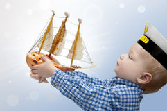 Free Small Captain With The Ship Stock Photography - 30174832