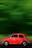 Small Car. Small red generic car speeding in the country side royalty free stock image