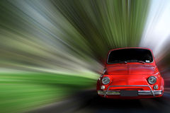 Small Car. Small red generic car speeding in the country side Stock Images