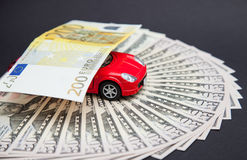 Small car carrying an euro banknote Royalty Free Stock Photography