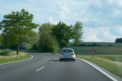 Small car on country road Royalty Free Stock Photo