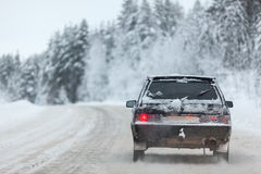 Small car driving on winter road, copyspace Royalty Free Stock Image