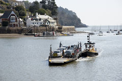 Small car ferry and a tugboat on River Dart UK Stock Image
