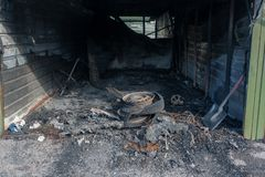 Small car garages that have been destroyed by a big fire, Vantaa Finland. Small car garages in the suburbs that have been destroyed by a big fire with , Vantaa royalty free stock photography