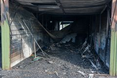 Small car garages that have been destroyed by a big fire, Vantaa Finland. Small car garages in the suburbs that have been destroyed by a big fire with , Vantaa royalty free stock photos