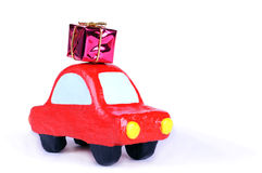 Small car with gift on top Stock Photos