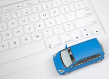 Small car on the keyboard Stock Image
