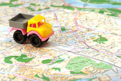 Small car on map Royalty Free Stock Photo