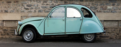 Small car. Small old Citroen car. A street in the city of Rennes, France stock images