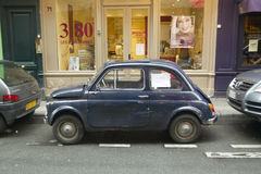 Small car parked on street, Paris, France Royalty Free Stock Image