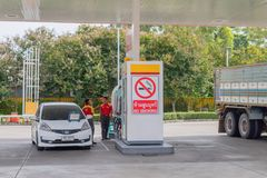 A small car is parking at oil dispener with no smoking sign of Shell gas station in Hua Hin, Thailand September 10, 2016. The small car is parking at oil stock photography