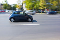 Small car running on the street Stock Image