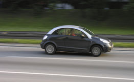 Small car speeding on a highway Stock Photo