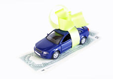 Small car stands on money Royalty Free Stock Photography