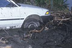 A small car stuck after the mudslides Royalty Free Stock Image