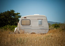 Small caravan parked in the field Stock Photo