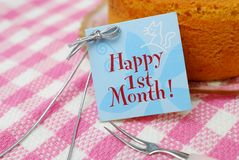 Small card beside cake Stock Photography