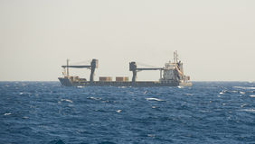 Small cargo ship at sea Royalty Free Stock Photos