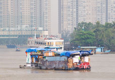 Small cargo vessel on Saigon River Stock Photo