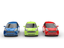 Small cars in a row - Red, Green and Blue - front view Stock Photos