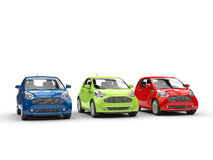 Small cars in a row - Red, Green and Blue Stock Photos