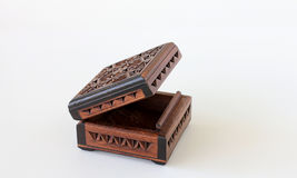 Small Carved Wood Box. Open small, square, and brown hand-carved wood box; on white background Royalty Free Stock Images
