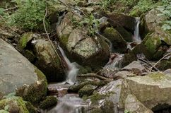 Small cascade on the mountain Royalty Free Stock Photo