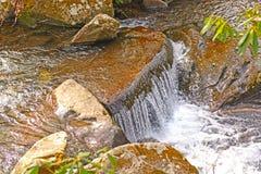 Small Cascade in a Mountain Stream Royalty Free Stock Photos