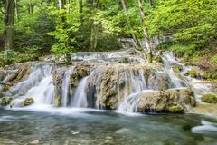 Small cascade on river Stock Photos