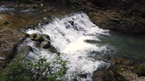 Small cascade on a river in grand canyon in China