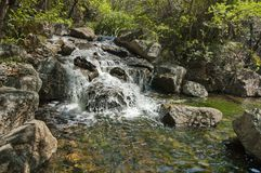 Small cascade waterfall by Palace of the Lost City hotel in Sun City Stock Image