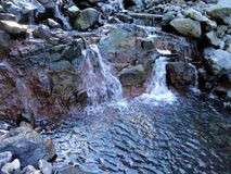 A small cascades cross on Heliotrope Ridge trail, Mount Baker Royalty Free Stock Images