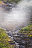 Small Cascading Stream on a Foggy Mountain Royalty Free Stock Photography