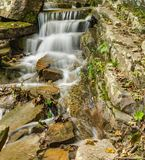 Small Cascading Waterfall. A small cascading waterfall at Roaring Run Waterfall located the mountains of the Jefferson National Forest, Botetourt County royalty free stock images