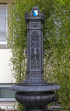 Small cast-iron fountain, Zurich, Switzerland. Royalty Free Stock Image