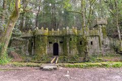 A tiny abandoned castle - Cangas, Spain. A small castle in the forest, now nearly completely overgrown - Cangas, Spain Royalty Free Stock Image